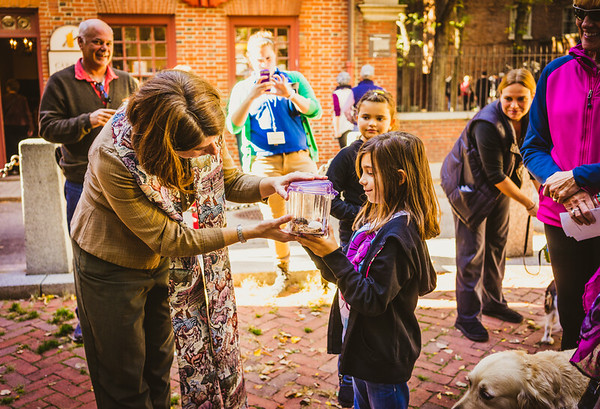 Talia presents Fred the Hermit Crab to Rev. Ellie Terry for the annual Blessing of the Animals