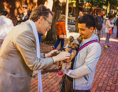 Old North's Rev. Steve Ayres blesses a pair of dogs