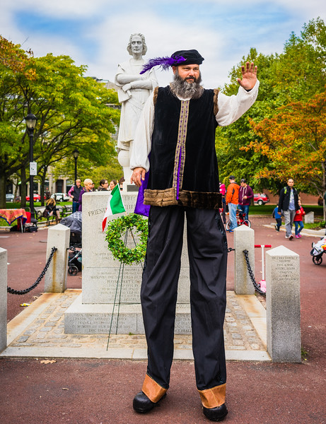 Christopher Columbus on stilts with his statue