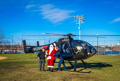Santa comes out of his helicopter