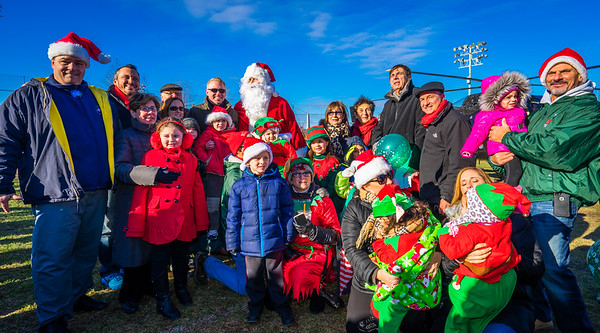 Young and old gather around Santa before the Christmas Parade