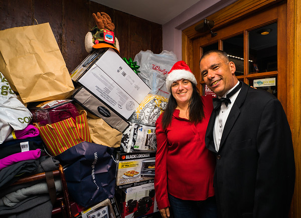 """North Street Grille owner, Robin Sidell, and Dan Connolly with donations to """"community serving"""""""