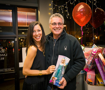 George Hadaya helped organize the toy donations, shown here with Toni Gilardi and his favorite toy