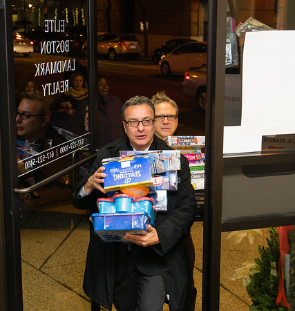 Councilor Sal LaMattina helps bring in toys donated by neighborhood businesses