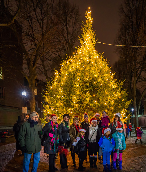 NEMPAC Christmas Carolers in front of the Prado tree