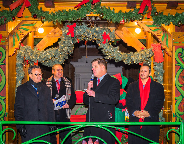 Mayor Marty Walsh speaks to the crowd on the Trolley Tour with Councilor Sal LaMattina and Rep. Aaron Michlewitz