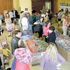 Dan Irwin/NEWS<br /> Teachers and community agency representatives from Lawrence and Mercer counties browse  among 400,000 free books that were being made available to them yesterday at Westminster College.