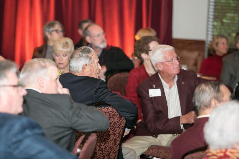 Bobby Bowden watching the TK video presentation Friday at the Alumni Association homecoming awards breakfast.