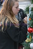 Faith Bushell Signs one of the Christmas Wish Bottles on the tree before the Christmas Parade Saturday