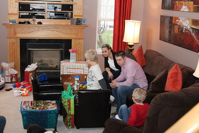 Kevin's house and the kids opening presents.