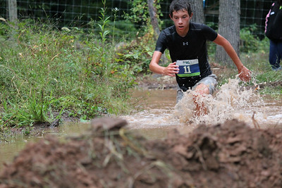 Winner, Dylan Herb makes his way through the mud on his way to the end of the Hard to the Core 5k Mud Run at Weaver's Orchard in Morgantown on Sept. 13. Photos by Gwen Bauer