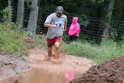 Michael Semo quickly runs through the mud pit.