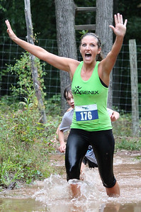 Jen Carmean excitedly makes her way through the muddy mess and to the finish line.