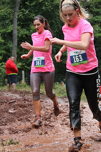 Felicia Bowman(left) and Natalie Ranck(right) battle together through the final mud pit.