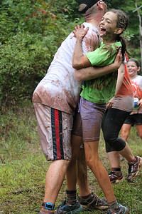 Charlie Trainer of Reading hugs Lillian Semo after battling through the final mud pit.