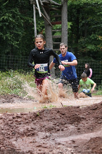 Gabriella Sainato runs through the last obstacle of the race.