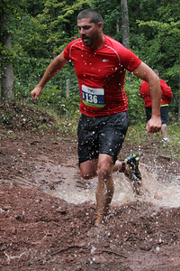 Stephen Gebhart powers through the mud to the finish.