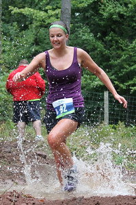 Erica Lewis races through the mud to the finish line at the Hard to the Core 5K Mud Run.
