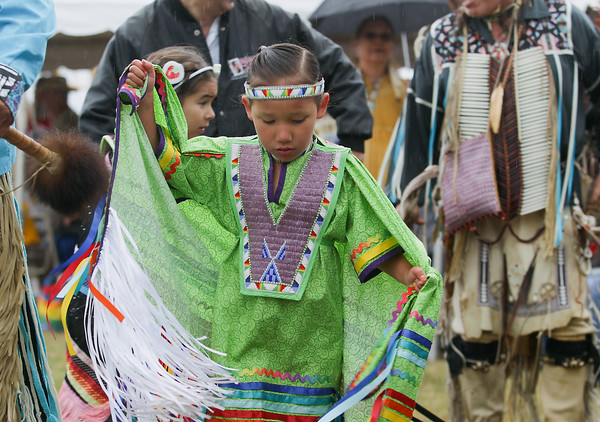 Record-Eagle/Keith King<br /> Akeela TwoCrow, 5, of Peshawbestown, dances in the Grand Traverse Band of Ottawa and Chippewa Indians Pow Wow during the National Cherry Festival in Traverse City.