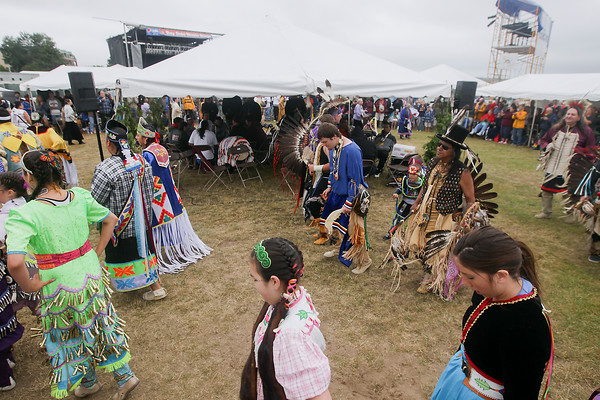 Record-Eagle/Keith King<br /> Participants dance in the Grand Entry as part of the Grand Traverse Band of Ottawa and Chippewa Indians Pow Wow during the National Cherry Festival.