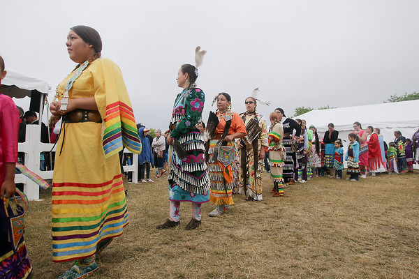 Record-Eagle/Keith King<br /> Participants make their way to dance in the Grand Traverse Band of Ottawa and Chippewa Indians Pow Wow during the National Cherry Festival.