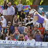 Record-Eagle/Keith King<br /> Spectators look on as a dog jumps during the National Cherry Festival Ultimate Air Dogs competition.