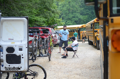Racers talk about the race beside the buses they'll take to the top.