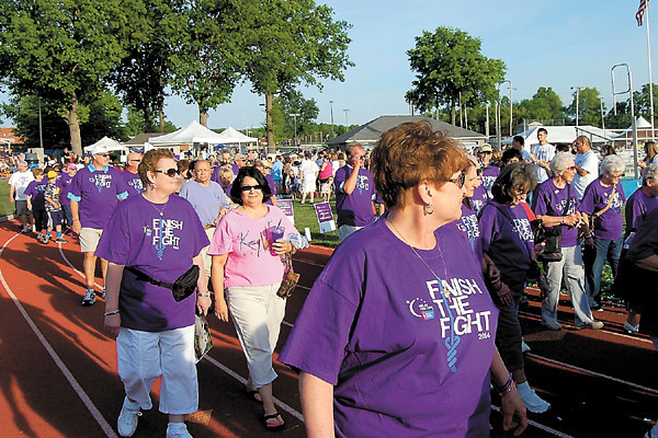The Survivors Walk is the first official lap of the Relay. More than 200 cancer survivors, each dressed in purple, participated. — Sam Luptak Jr.<br />