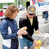 Mike and Janet Busin of Neshannock Township enjoy one of the free hot dogs. — Sam Luptak Jr.