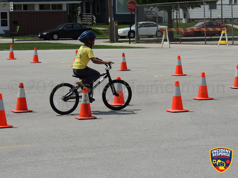 The Sheboygan Police Department hosted a Bicycle Rodeo at St. Peter Claver Church on Saturday, June 7, 2014. Photo by Asher Heimermann/Incident Response.