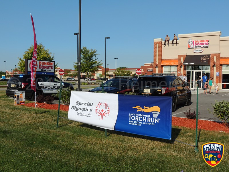 Sheboygan County law enforcement officers participate in Cop on a Rooftop benefiting Special Olympics Wisconsin at Dunkin' Donuts in Sheboygan, Wisconsin on Friday, August 15, 2014. Photo by Asher Heimermann/Incident Response.
