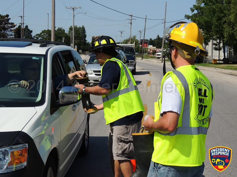 Sheboygan firefighters participated in the MDA Fill the Boot campaign at North 15th Street & North Avenue in Sheboygan, Wisconsin on Friday, August 15, 2014. Photo by Asher Heimermann/Incident Response.