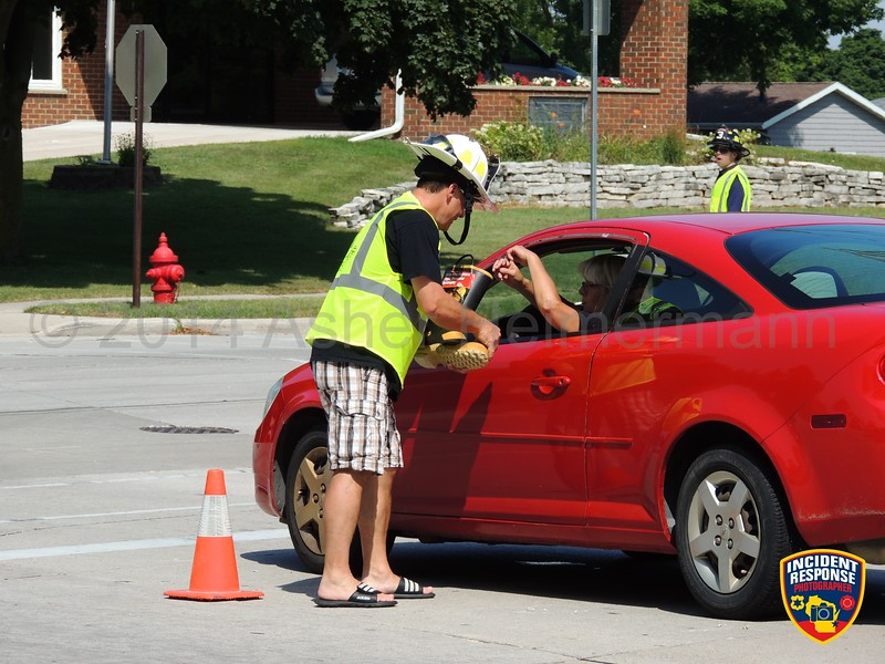 Sheboygan firefighters participated in the MDA Fill the Boot campaign at North 25th Street & Superior Avenue in Sheboygan, Wisconsin on Friday, August 22, 2014. Photo by Asher Heimermann/Incident Response.