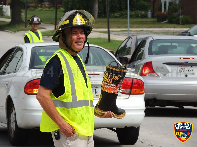 Sheboygan firefighters participated in the MDA Fill the Boot campaign at North 15th Street & North Avenue in Sheboygan, Wisconsin on Friday, August 22, 2014. Photo by Asher Heimermann/Incident Response.