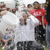 Student Government President,  Biruk Kassar participates in the Ice Bucket Challenge to help fund the fight against ALS at The University of North Carolina at Pembroke on Monday, August 25th, 2014.<br /> Ice_Bucket_Challenge_0096.JPG