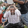 Student Government President,  Biruk Kassar participates in the Ice Bucket Challenge to help fund the fight against ALS at The University of North Carolina at Pembroke on Monday, August 25th, 2014.<br /> Ice_Bucket_Challenge_0098.JPG
