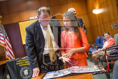 Senator Richard Burr presents Cailee Calabrese with honors for achieving her 3rd Level Gold President's Volunteer Award at the University of North Carolina at Pembroke on Friday, August 14th, 2014. Cailee_Calabrese_0028.CR2