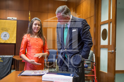 Senator Richard Burr presents Cailee Calabrese with honors for achieving her 3rd Level Gold President's Volunteer Award at the University of North Carolina at Pembroke on Friday, August 14th, 2014. Cailee_Calabrese_0085.CR2
