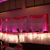 Pink uplighting behind head table by DJ Jason Rullo