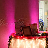Pink uplighting behind cake table by DJ Jason Rullo