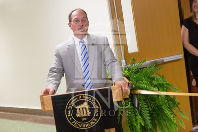 The University of North Carolina at Pembroke holds a Ribbon-Cutting Ceremony for the renovations to the Moore Hall Auditorium on Tuesday, August 26th, 2014. Moore_Hall_Auditorium_Ribbon_0017.JPG