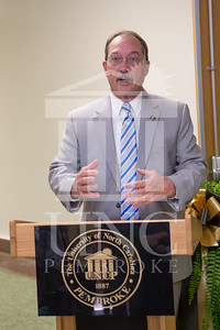 The University of North Carolina at Pembroke holds a Ribbon-Cutting Ceremony for the renovations to the Moore Hall Auditorium on Tuesday, August 26th, 2014. Moore_Hall_Auditorium_Ribbon_0012.JPG