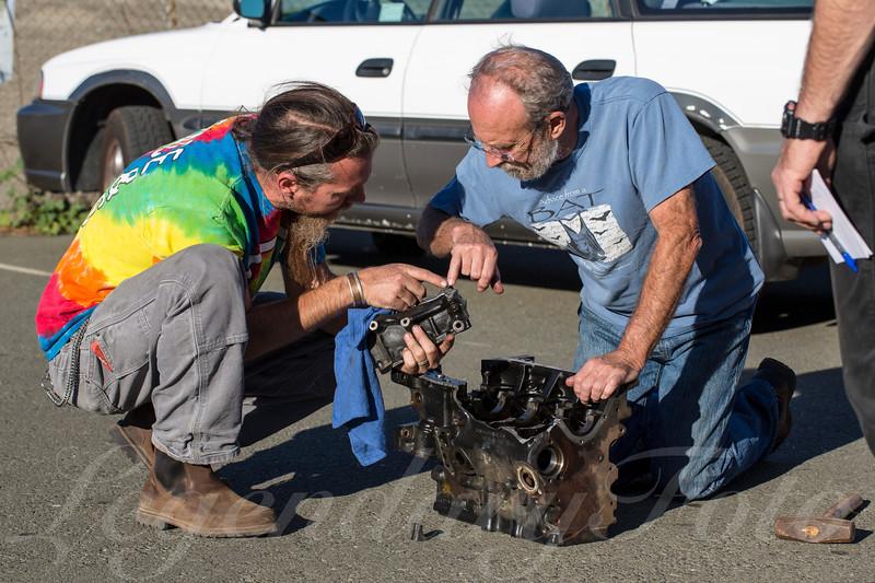 Jaysin Cabrol Inspecting a Broken Engine Block