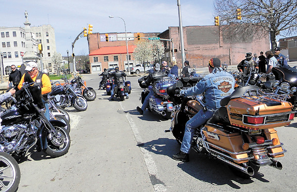 Their bikes blessed, some of the motorcyclists head out for a summer of riding the highways.