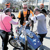 Bill Bloom, president of the Remnant Sons Motorcycle Club, prays over the bike of a couple visiting yesterday's Kennedy Square event.