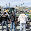 Motorcyclists join hands behind their bikes as Bill Bloom and Rich Shira pray for a blessing on the vehicles of all in attendance.