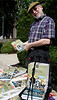 "Local author Frank Quattrone displays his second book about the borough, ""Legendary Locals of Ambler,"" during the Ambler Arts and Music Festival Saturday, June 13, 2015.<br /> Bob Raines--Montgomery Media"
