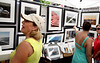 Suzanne Ries, left, looks at photographs by Michael Heayn along with her daughter-in-law, Alex Ries, center, and her sister-in-law, Barb Tomlinson during the Ambler Arts and Music Festival Saturday, June 13, 2015.<br /> Bob Raines--Montgomery Media