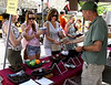 Mary Hoff, left, and Katie Dubinski wait for Eileen Dubinski to purchase a mosaic dish From Scott Martin, Mosaics and More, at the Ambler Arts and Music Festival Saturday, June 13, 2015.<br /> Bob Raines--Montgomery Media