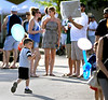 A lad with a balloon checks out another, right, with a balloon and a balloon sculpture at the Ambler Arts and Music Festival Saturday, June 13, 2015.<br /> Bob Raines--Montgomery Media